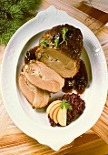 Braised leg of wild boar with prunes and red cabbage