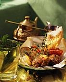 Tray-baked Turkish koftas with bread and potato wedges