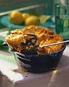 Greek spinach and sheep's cheese pie, one piece on spoon