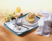 Breakfast tray with roll and jam, butter, coffee