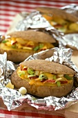 Baked potatoes with vegetable and apple stuffing