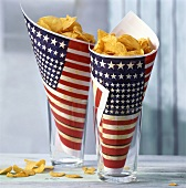 Potato crisps in packets with American design in glasses