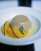 Chocolate panna cotta with orange sauce