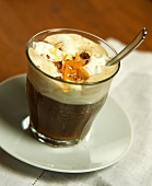 Iced coffee with whipped cream and orange zest