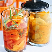 Pickled peppers and gherkins with turmeric in jars