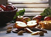 Still life with apples, almonds and apple cake