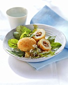 Deep-fried potatoes with walnut and anchovy stuffing on lettuce