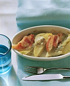 Potato casserole with fennel, pears and bacon