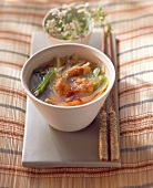 Asian vegetable soup with fried chicken breast fillet