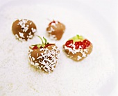 Chocolate-coated strawberries with grated coconut