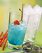 Blue Curacao drink with crushed ice & cocktail cherry