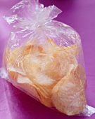 Potato crisps in plastic bag