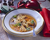 Cep bouillon with crepe rolls
