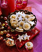 Nut and almond biscuits and cinnamon stars in a bowl