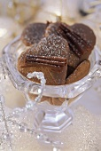 Heart-shaped chocolate-covered gingerbread in glass bowl