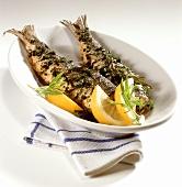 Fried herrings in herb coating