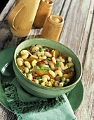 Vegetable soup with noodles and diced bacon