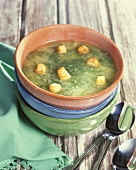 Cucumber soup with bread cubes