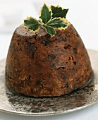Christmas pudding with sprig of holly