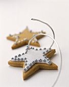 Star biscuits decorated with silver pearls as tree ornament