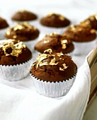Chocolate muffins with gold foil