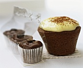 A large cappuccino muffin and small espresso muffins