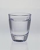 A glass of clear schnapps
