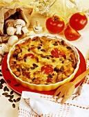 Turkey and mushroom casserole with tomatoes & pumpkin seeds