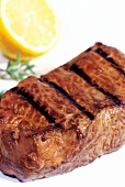 Grilled beef steak with lemon