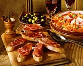Various Spanish appetisers on rustic table