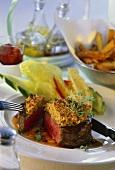 Fillet steak with mustard crust, cut into