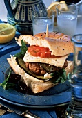 Flat bread sandwich with lamb meatballs and feta cheese