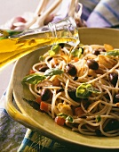 Spaghetti with olive oil, garlic, olives and pepper