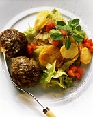 Meatballs with colourful fried potato salad