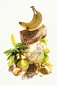 Still life with cauliflower, bread, fruit, nuts etc