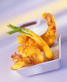 Scampi and spring onions in tempura pastry