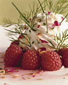 Raspberries with herb cream and rose petals
