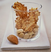 Almond pralines and almonds in a jar