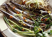 Fried sardines with spring onions