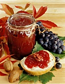 Grape jam in jar and on bread