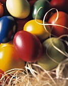 Colourful eggs on straw
