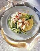 Lobster with curry sauce and courgettes