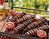 Sausage kebabs on the barbecue