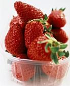 Fresh strawberries in plastic bowl