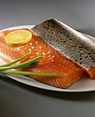 Salmon fillet with lime slice and spring onion