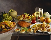 Buffet with savoury pastries, salmon, paella, pasta & champagne