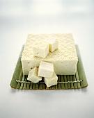 A piece of tofu and diced tofu