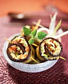 Aubergine roll with cheese and herb filling
