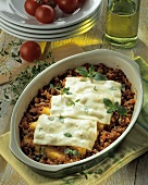 Polenta and mince bake topped with cheese slices