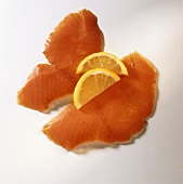 Two slices of smoked wild salmon garnished with lemon